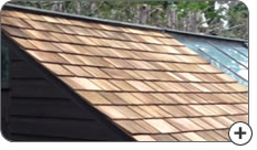 Shed roof renovation with wooden shingles